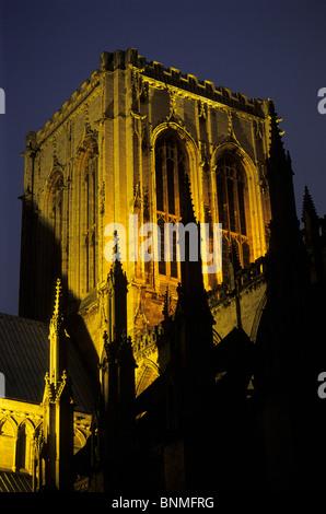 The central tower of York Minster floodlit at dusk, York. - Stock Image