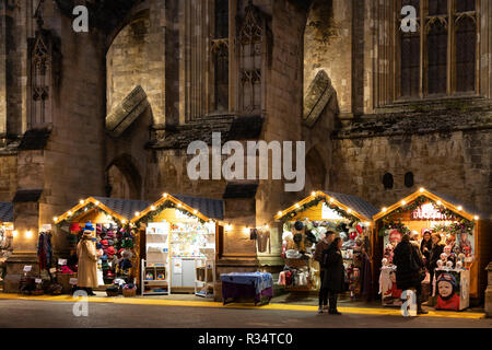 Gothic Winchester Cathedral at night and Christmas market in the medieval city of Winchester - Stock Image