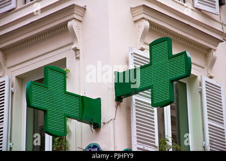 France, Paris, green cross drugstore sign - Stock Image