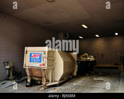 Commercial or industrial trash compacter and garbage bin for urban or city garbage or trash in Montgomery Alabama, USA. - Stock Image