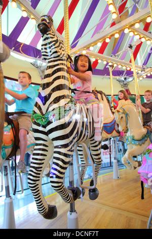 Children on carousel - Stock Image
