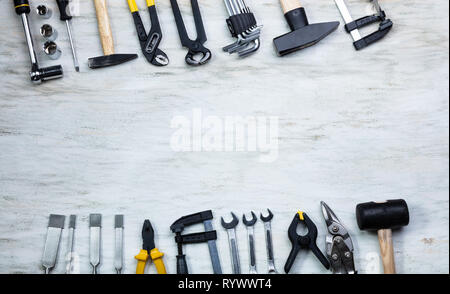 An Overhead View Of Many Yellow Repair Tools Arranged On Wooden Table - Stock Image