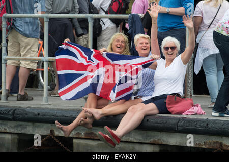 Portsmouth, UK. 25th July 2015. Crowds gather outside the BAR HQ in Camber Dock waving the Union Flag and waving - Stock Image
