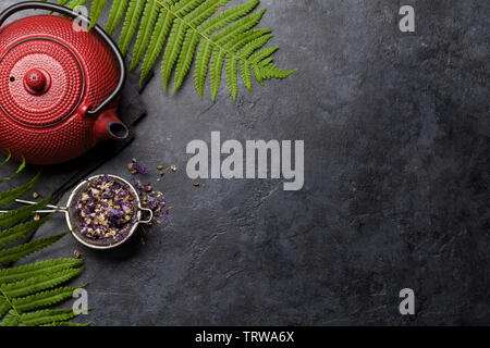 Herbal and fruit dry teas on stone table. Top view flat lay with copy space - Stock Image