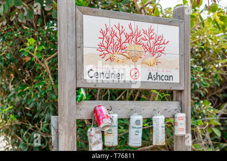 sign in St Barts saying cendrier ashcan with cans for putting out cigerettes at Grand Fond, St Barts, - Stock Image
