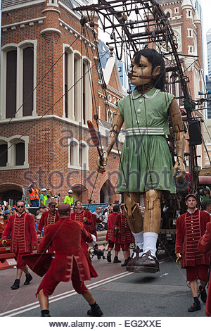 Royal De Luxe parade their Little Girl Giant marionette through the city of Perth, Western Australia, on February - Stock Image