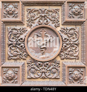COMO, ITALY - MAY 8, 2015: The metal - wooden relief with the instrumnest of Crucifixion on the gate of church Santuario del Santissimo Crocifisso. - Stock Image