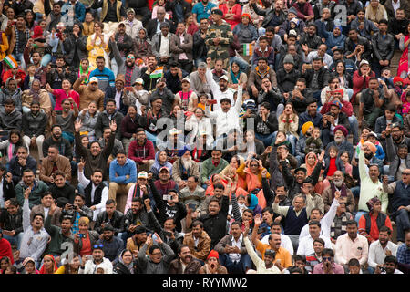 A crowd celebrates Indian military power the day after the Jaish-e-Mohammed terrorist attack in Indian-administered Kashmir. - Stock Image