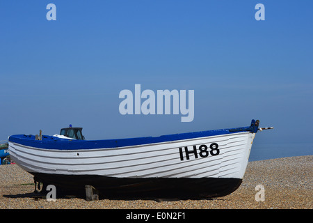 Antique, 19th century open rowboats, once used for fishing on the open sea, now beached on the shingle, near the Royal National Lifeboat Institute - Stock Image