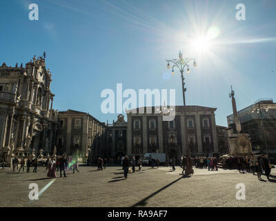 PIazza del Duomo with the Cathedral of Saint Agatha (Sant'Agata) left & the Elephant fountain, Catania, Sicily, Italy. - Stock Image