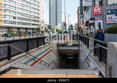 Steps lead down wards at an entrance into Chumgmuro metro station in Seoul, South Korea. - Stock Image