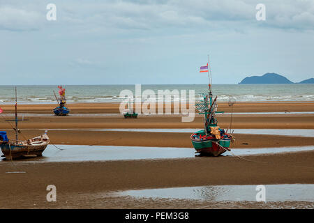 A squid fishing boat on the beach in Southern Thailand - Stock Image