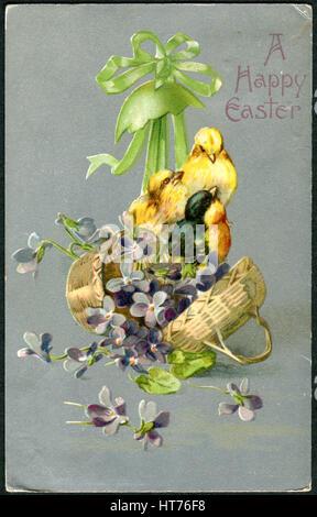 USA - CIRCA 1909: A Easter postcard printed in USA, shows a chicken in a floral basket, circa 1909 - Stock Image