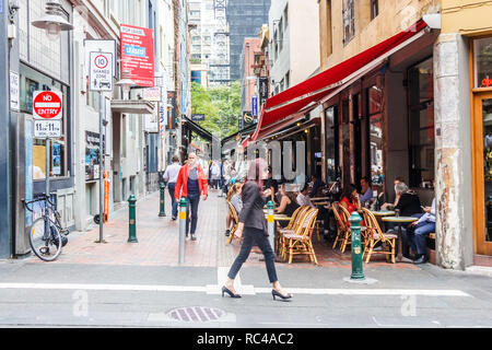 Melbourne, Australia - 21st February 2018: A woman walks past one of the lanes in the city. Th area is famous for its restaurants. - Stock Image