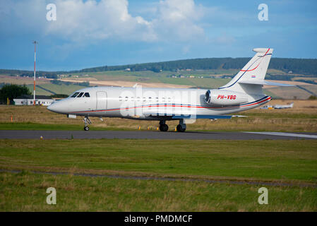 Arriving at Inverness Dalcross Airport is this Dassault 2000EX Private business Jet from Antwerp. - Stock Image