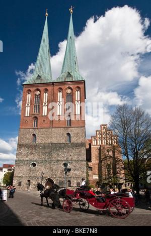 Carriage in front of Nikolaikriche, Nikolai church , Berlin, center, - Stock Image