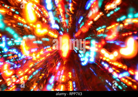 Multi-colored explosion of lights on dark background - Stock Image
