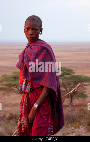 Tanzania, Olduvai. A Maasai boy sporting a fancy watch bathed in evening light. - Stock Image
