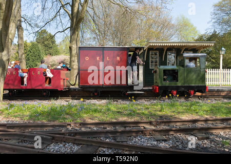 Train ride on the Old Kiln Light Railway, a narrow gauge railway at the Rural Life Centre, Tilford, Surrey, UK - Stock Image