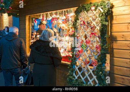 Christmas cabin selling decorations at St Nicholas Fayre York North Yorkshire England UK United Kingdom GB Great Britain - Stock Image
