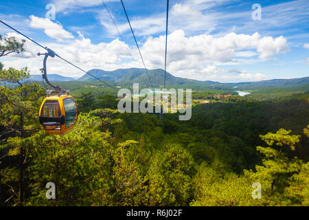 Beautiful panorama over mountains and the Truc Lam lake seen from the cable car, Dalat, Vietnam - Stock Image