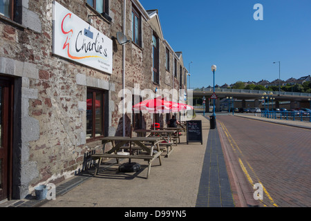 Charlie's bar and restaurant on the docks at Milford Haven - Stock Image