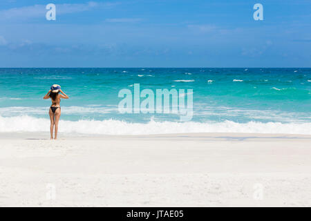 A young Brazilian woman in a bikini on Arraial do Cabo Beach, Rio de Janeiro State, Brazil - Stock Image