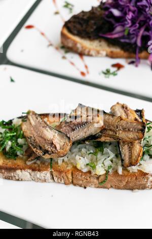 Portuguese tiborna open toast sandwich tapas with sardine and onion garlic snack - Stock Image