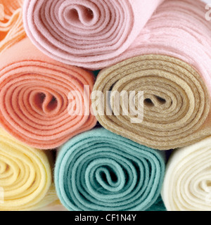 A still life shot of rolled up colourful scarves - Stock Image