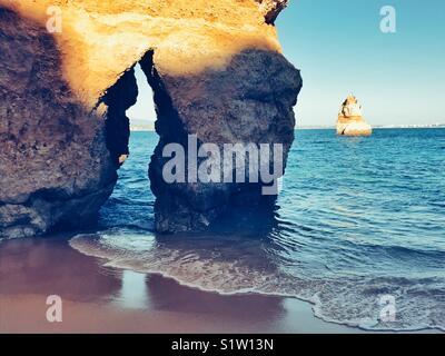 Door in the rock to the sea - Stock Image