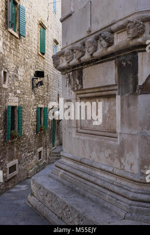 Human Heads of unknown individuals, Cathedral of St. James, Sibenik, Croatia - Stock Image