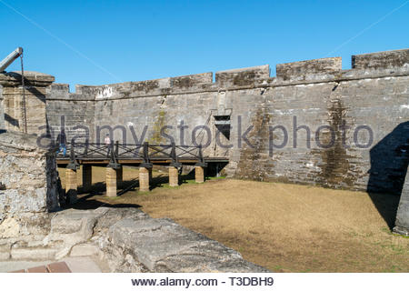 Footbridge to the portcullis entry at the Castillo de San Marcos, a Spanish fortification at St. Augustine, Florida USA - Stock Image