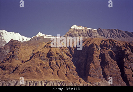Roc Noir 7485 metres and Tharpa Chuli or Tent Peak 5663 metres seen from Annapurna Base Camp with blue sky Nepal - Stock Image