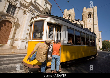 Portugal Lisbon Tram 28 Electrico in front of kathedral - Stock Image