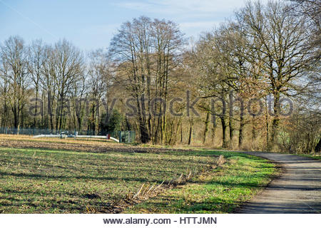 Ferngas (long-distance gas) pipeline distribution in rural landscape, northern Germany - Stock Image