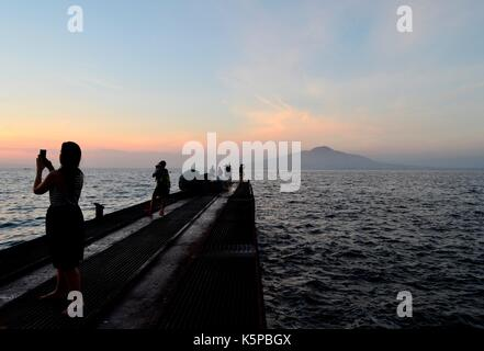 People take pictures of the beautiful sunset from the key of Marina Grande, Sorrento ,Italy, July 2017. - Stock Image