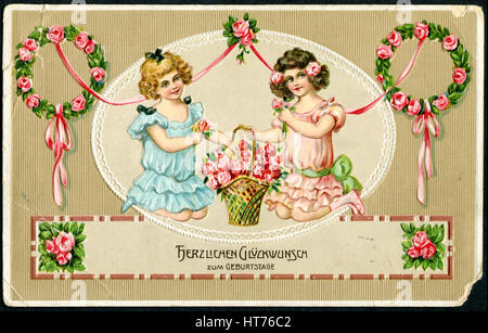 A greeting postcard printed in Germany, shows two happy girl with a bouquet of flowers. The inscription in German: - Stock Image