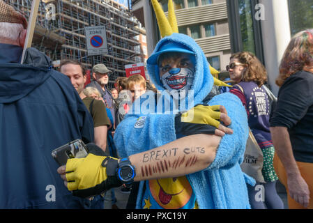 London, UK. 20th October 2018. A protester shows his arm with the message 'Brexit Cuts'.People gather with placards, banners and flags at Hyde Park Corner for the People's Vote March calling for a vote to give the final say on the Brexit deal or failure to get a deal. They say the new evidence which has come out since the referendum makes it essential to get a new mandate from the people to leave the EU. Peter Marshall/Alamy Live News - Stock Image