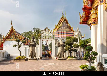 Bangkok, Thailand - 30th November 2014: Tourists walking through gateway, Wat Pho, The temple receives millions of visitors each year, - Stock Image
