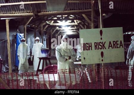 Ebola workers inside a treatment center in Kenema, Sierra Leone. - Stock Image