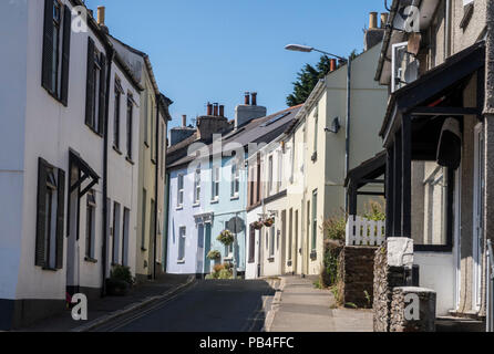 View of brightly coloured cottages on West Street, Millbrook, Cornwall - Stock Image