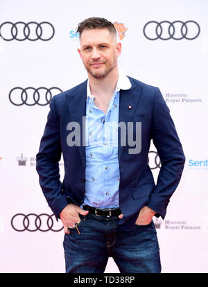 Tom Hardy arriving for a concert hosted by Sentebale in Hampton Court Palace in East Molesey, to raise awareness and vital funds for the Duke of Sussex's charity, Sentebale, which helps young people in southern Africa affected by HIV. - Stock Image