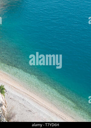 Hidden beach and calm blue sea on Adriatic sea coast - Stock Image