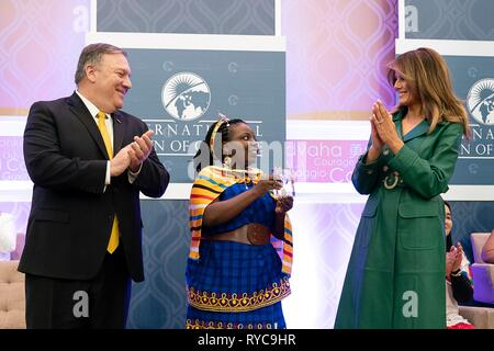 U.S First Lady Melania Trump, right, and Secretary of State Mike Pompeo, left, present Anna Aloys Henga of Tanzania with the 2019 International Women of Courage awards at the State Department March 7, 2019 in Washington, DC. - Stock Image