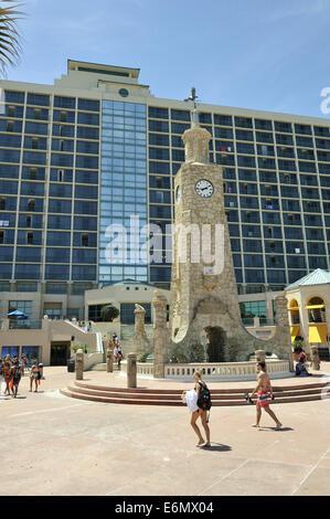 The Coquina Clock Tower in Daytona Beach's Oceanfront Park at Ocean Avenue. Daytona Beach, Florida, USA - Stock Image