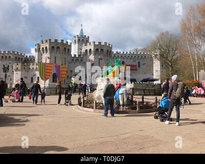 Crowds mill around a Lego Castle in the Knights Kingdom section of the LEGOLAND Windsor Resort UK - Stock Image
