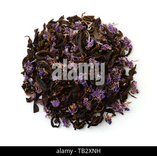 Top view of dry fermented herbal tea isolated on white - Stock Image