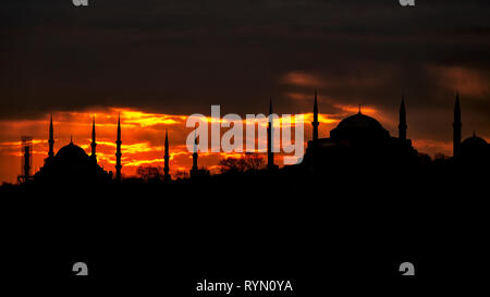 Silhouette of the Blue Mosque and Hagia Sophia at sunset, Istanbul - Stock Image