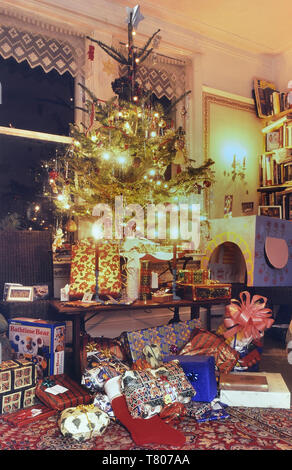 A real Christmas tree with presents, UK - Stock Image
