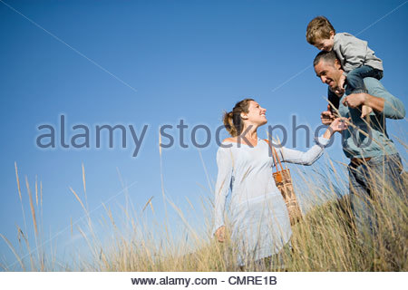 Family in a field - Stock Image